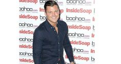 Mark Wright looks the ultimate cheeky chappy in a tight denim shirt and maroon chinos at the Inside Soap launch at Ross Restaurant!