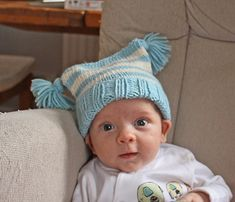 This striped baby hat is quick and easy to knit as a last-minute baby gift and is an ideal way to use up leftover yarn in aran or worsted weight. The brim is ribbed and the main body is striped in stocking stitch.