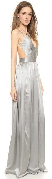 ONE by Contrarian Babs Bibb Maxi Dress This long silk dress features a deep V neck and an open back. Ruching at waist. Hidden side zip. Spaghetti straps. Double-layered at bodice.