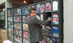 """""""Erik showing us the periodical shelving,"""" by Librarian In Black, via Flickr -- DOK is the public library in Delft, Netherlands. """"The most recent issue is tucked in vertically behind a plexiglass door, which swings out to store all of the back issues. Unlocked, completely accessible in all ways. Nice!"""""""