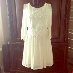 Host PickTopshop Cream dress Gorgeous cream colored dress with lace detail on top. Outer exterior: 100% polyester, Contrast: 77% cotton, 23% nylon, Lining: 65% polyester 35% cotton. Topshop Dresses