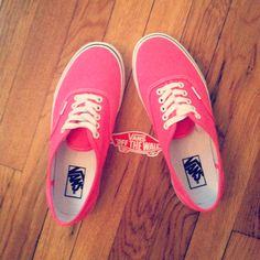 Neon pink authentic vans off the wall.