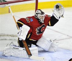 Calgary Flames goalie Miikka Kiprusoff, from Finland, makes a save during second period NHL action against the Anaheim Ducks in Calgary, Alberta, Friday, April 19, 2013