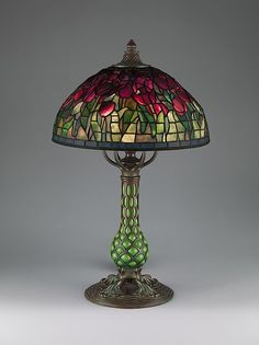 """""""Tulip"""" lamp by Tiffany Studios made with leaded Favrile glass and patinated bronze with a reticulated blown glass base between 1907 and 1912. (The Metropolitan Museum of Art, i.e. The Met Museum, 2017)"""
