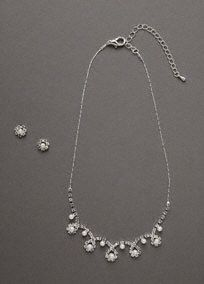 Pearls and crystals come together in a delicate design. Wear together for a perfectly accessorized look or separately for something simple and elegant!   Timelesspearl and crystal necklace and earring set.  Earringsfeature stud pearls encircled by crystals.  Adjustable lobster clasp.  Imported.