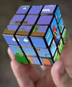 Whoever said video games rot the mind clearly never tried their hand at the Super Mario Bros Rubik's Cube. Each side of this Nintendo themed Rubik's Cube . Mario Bros., Mario Party, Mario Toys, Deco Gamer, Retro Game, Nintendo, Cube Puzzle, Mario Brothers, Video Game Art