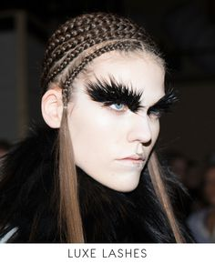 Extreme eyelashes aren't just for evening anymore. False strips turned up in multiples at Versace, Gucci, and Rochas, where they lent a glamorous, feline touch to even the most refined daywear. At Missoni, clumpy, morning-after mascara packed serious attitude, while Prada's caked-on lashes conveyed a quirkier feminine sensuality.