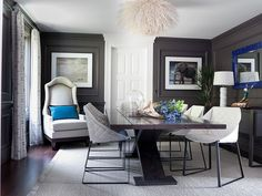 Dining room dark gray walls with royal blue accents