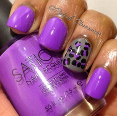 Purple nail w/ a leopard print accenter. I neeeed these