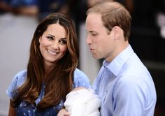 You can tell by the way she is looking at him how much she loves him. The Royal couple stand with their one-day-old son outside of St Mary's Hospital in London.