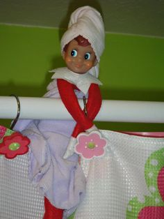 Elf on the Shelf in the shower with towel
