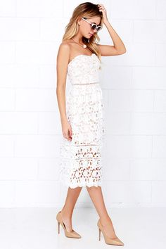 As Seen On Maria of @miamiamine! Lulus Exclusive! It's obvious that you've reached the height of fashion when you don the Pinnacle of Prestige Ivory Lace Midi Dress! Stunning floral lace bodice with beige lining is decorated with pierced embroidery beneath a sweetheart neckline and expert tailoring. Detachable spaghetti straps are adjustable, and can be removed for a strapless look that is assisted by a no-slip strip. Flaring midi skirt completes the stunning silhouette with sheer lace…