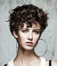 Short curly hair with bangs.