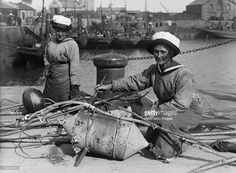 Getty Images caption 'Women In Uniform During The First World War: The Women's Royal Naval Service, Lowestoft, 1918, Two WRNS ratings sit in the sunshine on the quayside at Lowestoft to paint mines and steel floats, 1918. Both women are wearing their summer caps. Lowestoft was an important base for minesweepers, circa 1918. (Photo by G P Lewis/ IWM via Getty Images)'.  Probably IWM Q 19649.