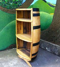 Scotsmen remaking whiskey barrels into bookshelves. All kinds of hot.