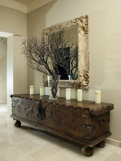 Love this look - large scale antique chest and mirror against a sleek neutral backdrop.