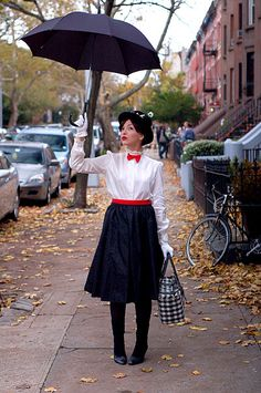Mary Poppins: Mary Poppins is definitely one supercalifragilisticexpialidocious Halloween costume! What you need to do: Get a black umbrella, long black skirt, white collared button-down shirt, red bow tie, white gloves, black pantyhose, and a black hat. Source: Keiko Lynn
