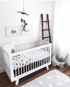 NURSERY / / White furniture and decor with timber floors looks so good in a gender neutral nursery - perfect for a calm, stylish nursery for a boy or a girl. By stylish mama @_kellypacker ✔️