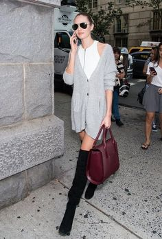 Candice Swanepoel autumn street style with cardigan and knee-high boots. #candiceswanepoel