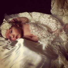 Our newborn pictures done in my wedding dress