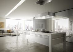 """Skylift, the only hood which is integrated into the ceiling and is coming down on the hob. This new model has an exceptional mobility: supported by 4 steel cables, goes down on the stove when you are ready to use it and goes back when it is no longer in operation, thanks to the """"up & down"""" Faber technology."""