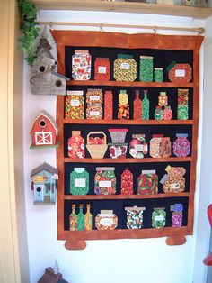What fun adding in a basket, a couple of different styled jars and adding feet to the bottom of the shelces.  Love the way it is displayed.