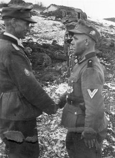 Generalleutnant Georg Ritter von Hengl decorates members of 146.Regiment, 2.Mountain Division with Iron Crosses, probably March-April 1942. Belonging to  Gebirgskorps Norwegen (Mountain Corps Norway) the division was deployed at the time to a failed attempt to reach the Soviet port of Murmansk.