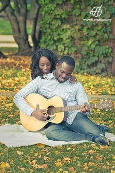 Navy Pier Engagement Session in Fall Chicago area couple posing with guitar yellow leafs around  Photo by Doru Halip for http://www.h.photography