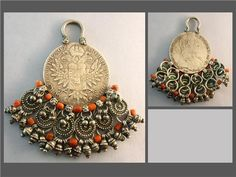 Maria Theresia Thaler pendant, decorated with Mediterranean antique coral and dangling silver beads.
