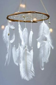 Boho feather dream catcher mobile. Maybe use doily + embroidery hoop