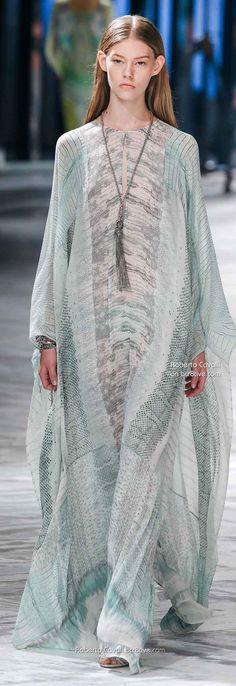 Roberto Cavalli Spring 2014 Milan. Cavalli does sooooo many of my lighter colors in extremely reccy styles! Tho im supposed to be more body concious, it struck me the caftans in light material that reveal body lines would be great in hot weather..i mean, you can read the body lines in this photo..