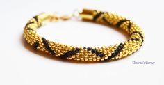 Yellow gold with matt black stripes handmade bead bracelet  see more: https://www.facebook.com/ElmirkasCorner/posts/854092708031483
