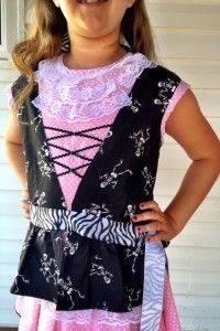 Homemade girls pirate costume bodice - black bodice with lace trim over pink dress and zebra bow. Sewn by grandma on sewing machine.
