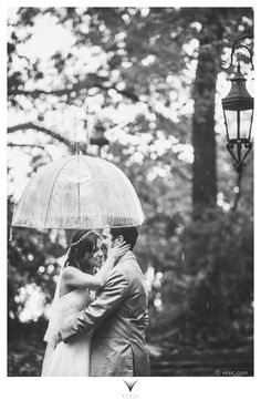 Such a sweet rainy wedding day shot! | Vesic Photography
