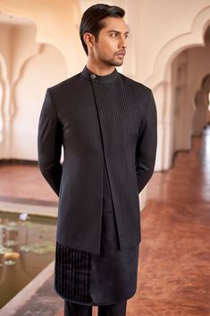 Black Bandhgala With Shell Tucks On Yoke Panel Paired With Black Kurta With Gold Zari & Cutdana Embroidery & Black Slim Fit Trouser by SS Homme India Fashion Men, Indian Men Fashion, Mens Fashion Wear, Big Men Fashion, Suit Fashion, Mens Indian Wear, Mens Ethnic Wear, Indian Groom Wear, Wedding Dresses Men Indian
