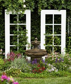 Repurposed Doors - some great ideas here, like this beautiful garden trellis.
