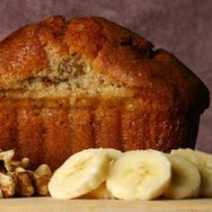 Banana bread fresh out of the oven with slices of ripe bananas.