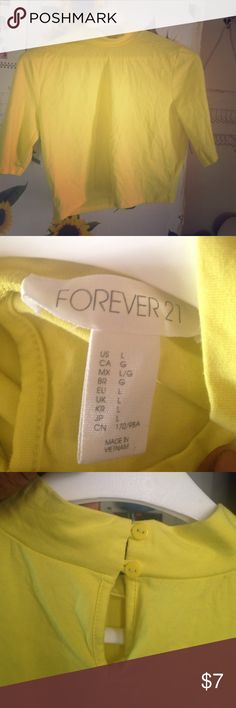 Forever 21 Crop top This is a yellow mock button neck crop top. Perfect for summer or spring. Forever 21 Tops Crop Tops