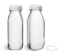 Glass Bottles, Clear Glass Tall Dairy Bottles with White Tamper Evident Caps are good for packaging for beverages like creams and milks.