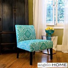 This beautiful jewel-tone angelo:HOME Bradstreet armless chair was designed by Angelo Surmelis. The Bradstreet chair is covered in a turquoise blue and white classic damask with dark espresso wood legs.