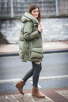 Master the effortlessly chic look in an olive puffer coat and black leather skinny jeans. Dress down this getup with brown uggs.   Shop this look on Lookastic: https://lookastic.com/women/looks/olive-puffer-coat-black-leather-skinny-jeans-brown-uggs/15044   — Black Leather Skinny Jeans  — Brown Uggs  — Olive Puffer Coat