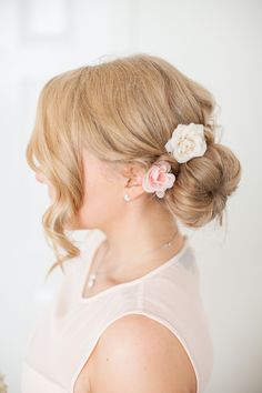 Side bun with flowers. A cute hair do for any dressy occasion.