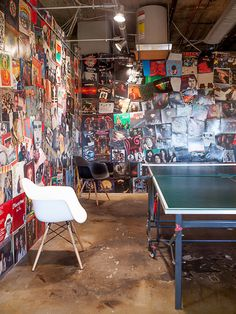 hang out space with ping pong table and walls covered in posters and album covers (Sara Costello)