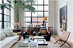 Tropical city loft living room, love that huge palm inside! Zeitgenössisches Apartment, New York City Apartment, City Apartments, Studio Apartment, Home Living Room, Living Room Decor, Living Spaces, Contemporary Apartment, Contemporary Decor