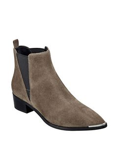 Ultra chic suede boots with a point toe and angular elastic goring for added comfort and flair.