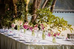 Native purple and white orchids decorate our table. White Orchids, Table Flowers, Beautiful Islands, Unique Weddings, Florals, Rustic, Table Decorations, Purple, Inspiration