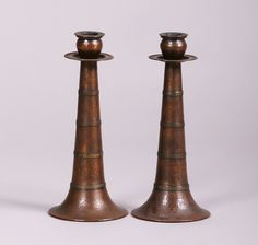 """Pair of Stickley Brothers tall hammered copper and brass candlesticks #131.   Signed """"131"""" on bottom.  Excellent original patina.  1 5/8″h x 5″d 