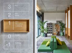 Office signage made of wood on polished concrete and green space to relax in the office