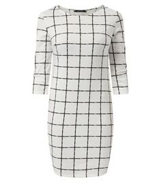 Try this grid print mini with peep toe heeled boots for an alternative party look this season.- 3/4 sleeves- Bodycon fit- All over grid print- Rounded neckline- Dress length: 35