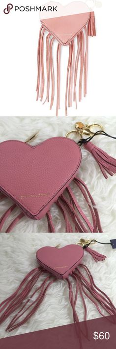 Rebecca Minkoff Heart Fringe Pouch Rebecca Minkoff heart fringe pouch. Use as key chain or hook to a purse or bag with clip. Gold hardware. Genuine leather. Pink. Zip closure. Rebecca Minkoff Accessories Key & Card Holders